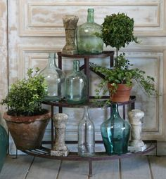 awesome plant shelf! Could be made with a vintage construction cart. LOVE the old bottles!