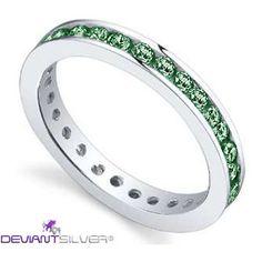 """Gli anelli fedine con luminosi zirconi smeraldo, gioielli in Argento 925/1000: la fedina """"BABY NATURE"""" è un gioiello caratterizzato dalla rivière di luminosi Zirconi color smeraldo a tuttogiro nell'argento di finitura lucida."""