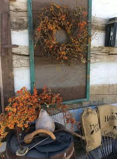 love the screen window for wreath display on porch