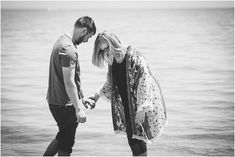 couple walking in lake michigan