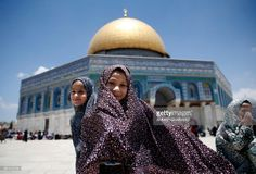 TOPSHOT - Palestinian girls stand in front the Dome of the Rock as they attend the first Friday prayers of the Muslim holy month of Ramadan at Jerusalem's al-Aqsa mosque compound on June 2, 2017. / AFP PHOTO / AHMAD GHARABLI        (Photo credit should read AHMAD GHARABLI/AFP/Getty Images)