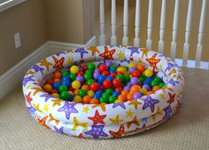 """Whenever we have play dates, the ball pit is one of the most popular hangouts in the playroom. Seriously the kids LOVE it! We've had this ball pit since Jake was 6 months old and it's still one of his favorite toys. You can easily make your own with an inflatable swimming pool and pit balls (we used 200). """