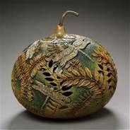 modern gourd art. beautiful use of textures and color..  Probably by Marilyn Sunderland, excellent gourd carver artist.