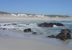 Pearl Bay Beach is backed by seacliffs offering standout views of Dassen Island, Table Mountain and the Atlantic Ocean. Table Mountain, Beach Houses, Atlantic Ocean, Watercolor Art, South Africa, Beaches, Cape, Outdoors, Dreams