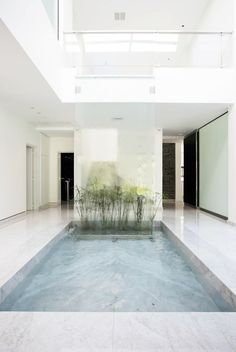 White entrance with water element