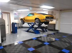 #RaceDeck floored home garage with infloor car lift - #coolgarages #garageflooring