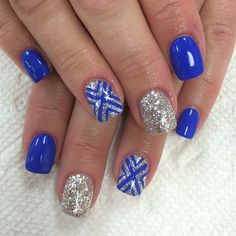 Make way for this royal blue and silver glitter ensemble. The nails are coated with royal blue matte and accented with silver glitter topped with royal blue symbols painted on top. If you want to look classy and sassy then this is the nail art to go for. Gorgeous Nails, Pretty Nails, Nails Polish, My Nails, Silver Nail Art, Silver Glitter, Blue And Silver Nails, Chevron Nails, Prom Nails