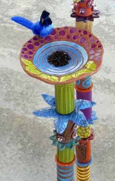 Totem for birds.  Love these. the color, whimsy, & style. Bird Furnishings