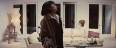 Uma Thurman as Mia Wallace in Pulp Fiction with her '90s style home decor. Details: http://observer.com/2014/10/every-single-amazing-90s-look-from-pulp-fiction-in-order-of-appearance/