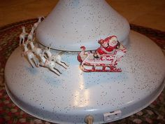 Vintage Christmas Tree Stand ~ Santa and Eight Tiny Reindeer * When plugged in, Santa and his reindeer fly around the stand and it also plays music. Circa, 1950's.