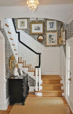 Entrance idea for home. Wainscoting at the bottom with a fun zebra print wallpaper on the top!
