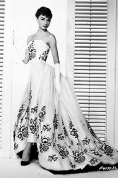 Audrey Hepburn wearing a floral embroidered gown in a promotional portrait for 1954's Sabrina - Hubert de Givenchy.