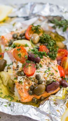 Mediterranean Salmon Foil Packets with capers olives oregano garlic and tomatoes are incredibly flavorful flaky and tender ready in just 20 minutes. Salmon Recipes, Fish Recipes, Seafood Recipes, Cooking Recipes, Healthy Recipes, Clean Recipes, Mediterranean Salmon, Mediterranean Diet Recipes, Fish Dishes