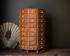 In original condition, this early wooden spinning parts cabinet is a great piece of early vintage industrial America. The cabinet sits on a