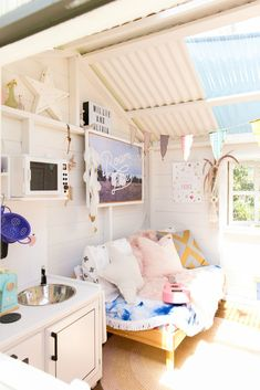 This house is actually a shed — a standard shed you'd find in the backyard of many Australian homes. Casa Wendy, Wendy House, Playhouse Interior, Shed Interior, Playhouse Decor, Playhouse Ideas, Kids Cubby Houses, Play Houses, Backyard Sheds