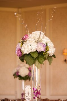 Table Setting bouquets from Classy Flowers at St George's Golf and Country Club. photo: www.eyecontact.ca