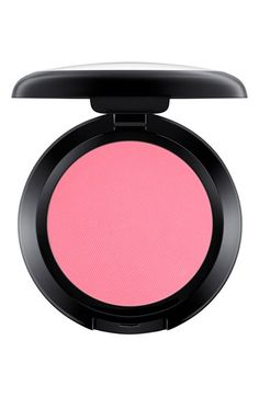 Adding a bold pop of pink to the cheeks with this blush by MAC.