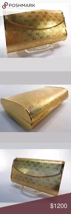 Rare 60s-70s Gold Vintage Metal Gucci Clutch Vintage 60-70s metal Gucci clutch    Lining falling apart from age (I'm not sure where it can be repaired) Hard style clutch with gg logos throughout  ***Open to offers*** ***No trades*** Gucci Bags