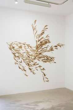 "Gabriel Orozco, Roiseau 3, 2012. Bamboo branch and bird feathers, 190 x 190 x 150 cm | 6' 2"" 6/8 x 6' 2"" 6/8 x 4' 11"""