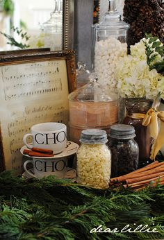 hot chocolate station for the holidays.  I always do something like this but love the greenery and old mason jars!! adding to this years lay out.