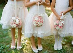 Kissing Balls: Instead of a traditional bouquet, have your florist make kissing balls for your flower girls. Theyre easy to carry and look oh-so sweet. Photo by Kate Headley Photography via Style Me Pretty