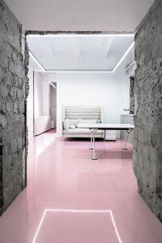 I think the pink concrete floors really work in this industrial workspace.