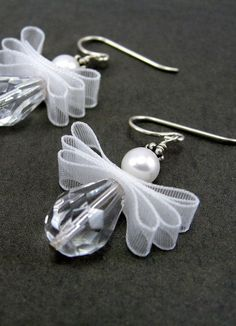 Sweet angel earrings with organza wings! Made from white swarovski crystal pearls, clear firepolish teardrop beads, white organza ribbon and