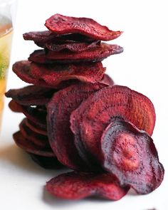 Beet Chips = thinly sliced beets and olive oil = happy children. Toss sliced beets in extra-virgin olive oil. Create a single layer of beets on cookie sheets. Bake 20 minutes at 350 F. Turn beets and bake another 10 -20 minutes.