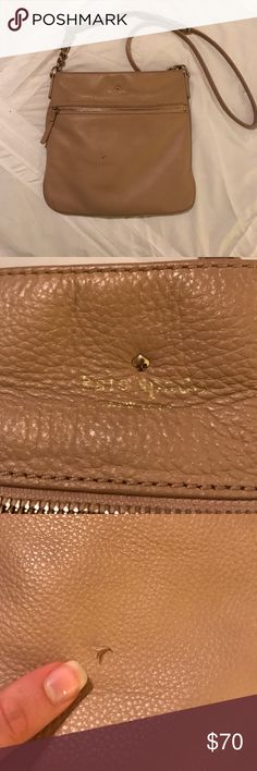 Kate Spade crossbody bag Was purchased for a study abroad trip Bc of the size. Can fit a large wallet, a phone, passport, a few makeup products & still have room. There are signs of wear (see pics). However I bought it with the slight tear in the front. There are no stains on the inside. The color is a light tan. Strap is adjustable. Make me an offer! kate spade Bags Crossbody Bags
