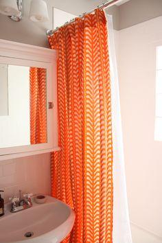 bright shower curtain in neutral bathroom