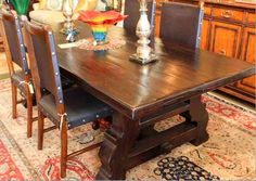 Reclaimed Wood Spanish Trestle Dining Table in a Distressed Dark Stain Finish mediterranean dining tables.....I want this table!!!!!