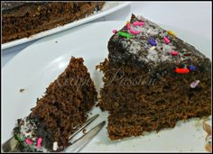 Rich Chocolate Fudge Layer Cake Top it with some Thick Chocolate Sauce, desiccated coconut, colored sprinkles and the Chocolate chips.