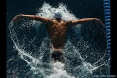 Michael Phelps.  I love his muscle definition and the aerial shot of the fly.