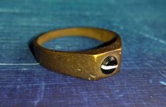 Medieval bronze ring with an unusual stone. An artifact of the 17th century
