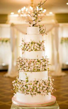 White wedding cake with spray roses.