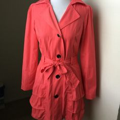 """NWTPerf for SpringBeltedTrench Jkt Xhileration NWT! Perfect for Spring!! Beautiful Xhileration Belted Trench Jacket - color is salmon/Peach - beautiful Ruffles on bottom gives you a great hourglass shape - BRAND NEW!! Bust 17"""", length 34.5"""", shoulders 14.5"""", sleeve underarm 18"""". Shell 55% cotton 45% polyester; lining 100% polyester. Includes extra button that is sewn into the tag underneath. Xhilaration Jackets & Coats Trench Coats"""