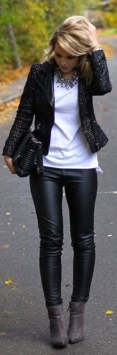 Monochrome fashion with leather leggings.: