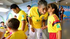 Neymar is kissed by a player escort in the tunnel