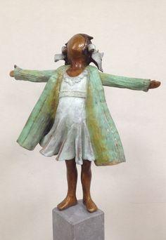 slecht weer bestaat niet!  bronzen beeld van Babke Moelee