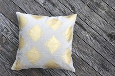I Cant Believe Its Etsy: Decorator-Worthy Throw Pillows: Hand printed in metallic paints on European hemp fabric, this pillow raises the bar on lumbar pillows ($75),  big time. : This wood block pillow ($22) is a whale of a good time. (Sorry, we couldn't resist!) : A geometric-style tribal print in gold? Yes, please. This hand-printed pillow ($90) would look great as the final accessory on a well-made bed.