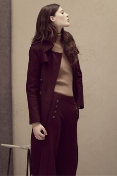 A wine coloured coat and trouser finished off with a beige polo neck.  Autumn/Winter preview.
