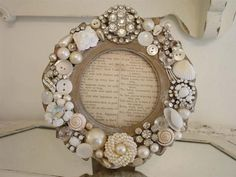 frame collaged with vintage jewelry, buttons, rhinestones