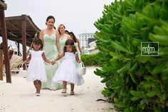 Bridesmaids entrance to the ceremony. Sandos Cancun Wedding Photographer. Riviera Maya Wedding Planning. Best Destination Wedding day in Mexico. Unique ideas for your ceremony, newlyweds & reception! MTM Photography
