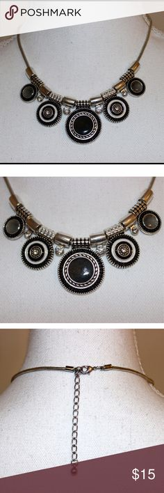 """Black Pendant Necklace This stunning necklace has rhinestones and enamel pendants that are various shades of black. It is made of silver plated alloy metals and is 16.5"""" long plus a 2"""" extender. It is brand new without tags, and is sure to be an eye catcher! Jewelry Necklaces"""