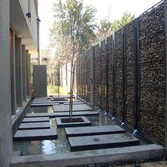 mur gabion comme élément fonctionnel brise-vue et accent décoratif