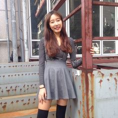 Korean employee Damee layers the Ponte Sleeveless Skater Dress over the Striped Long Sleeve Crop Top.