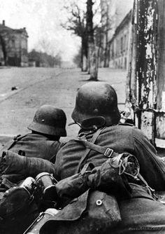 German soldiers in a street battle. Kharkov, 1941.