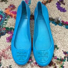 TORY BURCH TEAL RAIN FLATS Super cute pair of Tory BURCH teal rain flats! These are solid rubber jelly material and they are meant to be able to get wet! RAINBOOTS material! No size listed, but when I purchased off another posher they were a size 8 I believe. They measure about 10inches from heel to toe. Super cute for spring! I purchased them PRELOVED and haven't worn them. Please see pictures of right shoe for darkening. I'm pricing low due to the discoloration and because they aren't new…