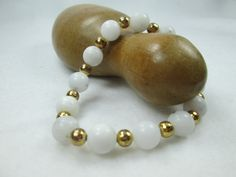 A BEAUTIFUL WHITE QUARTZ AND GOLD METAL BEADED STRETCH BRACELET IS PERFECT FOR A WEDDING.  THIS BRACELET WOULD BE LOVELY LAYERED OR BY ITSELF.  IT IS HANDMADE AND MAKES A B...