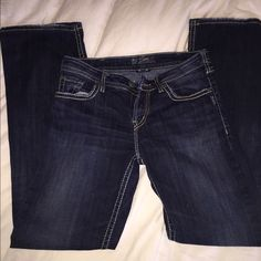 Silver bootcut jeans Silver bootcut dark wash jeans. Light fray and use on the cuffs Silver Jeans Jeans Boot Cut